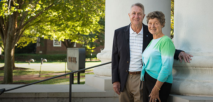 Bob and Jane Gore in front of Gore Hall on the University of Delaware campus