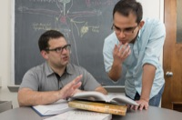 UD assistant professor Ryan Zurakowski (left) has reported a new modeling technique that reveals HIV may be replicating in the body even when undetectable in the blood. With him is Fabian Cardozo, a UD doctoral student and co-author of the paper.